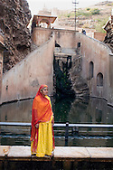 Woman standing in front of water, India