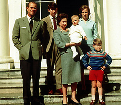 File photo dated 21/04/1965 of Queen Elizabeth II holding Prince Edward and surrounded by her family, (left to right), the Duke of Edinburgh, Prince Charles, Princess Anne, and Prince Andrew at Windsor on the occasion of the Queen's 39th birthday. The Royal couple will celebrate their platinum wedding anniversary on November 20.