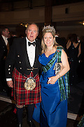 LORD BIDDULPH, MRS. HOUSTON MORRIS; , The Royal Caledonian Ball 2015. Grosvenor House. Park Lane, London. 1 May 2015.