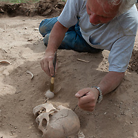 MONGOLIA. Smithsonian archaeologist & forensics specialist, Dr. Bruno Frohlich, unearths bronze-age skeleton at site above Delger River near Muren.  Skeleton may be 2700+ years old.  <br /> <br /> #MS0702_060628_0295.NEF