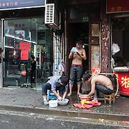 China, Shanghai. Quipu market area, street sellers