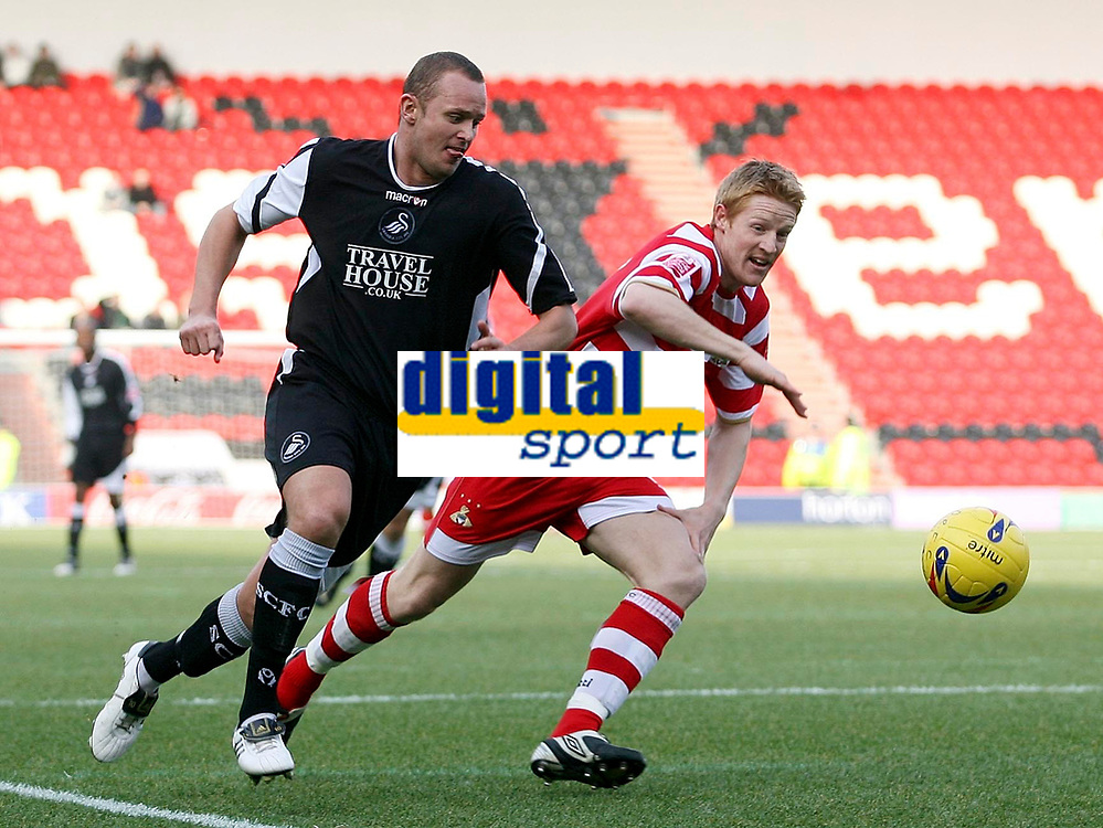 Photo: Paul Thomas.<br /> Doncaster Rovers v Swansea City. Coca Cola League 1. 17/02/2007.<br /> <br /> Lee Trundle (L) of Swansea tries to get by Brian Stock.