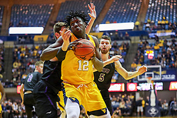 Mar 20, 2019; Morgantown, WV, USA; West Virginia Mountaineers forward Andrew Gordon (12) makes a move during the second half against the Grand Canyon Antelopes at WVU Coliseum. Mandatory Credit: Ben Queen