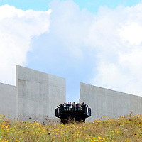 Vistors to the Names at the Flight 93 National Memorial stand on the overlook at the visitors center to see the crash site of Flight 93 and the Wall of Names on the 15th anniversary of  the the crash of the Flight 93 on September 11, 2016.  Photo by Archie Carpenter/UPI