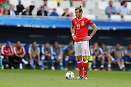 Gareth Bale of Wales stands waiting to take a free-kick from which he scores his goal. Euro 2016, Wales v Slovakia at Matmut Atlantique , Nouveau Stade de Bordeaux  in Bordeaux, France on Saturday 11th June 2016, pic by  Andrew Orchard, Andrew Orchard sports photography.
