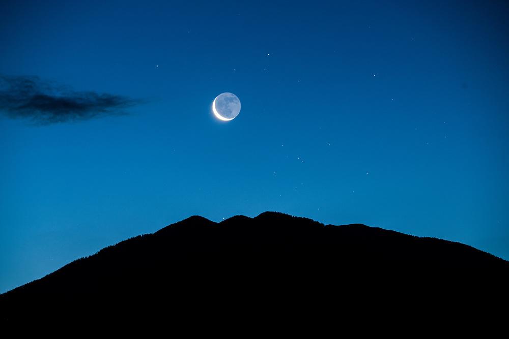 Taos Mountain moonrise, 4:30 a.m., El Prado, New Mexico