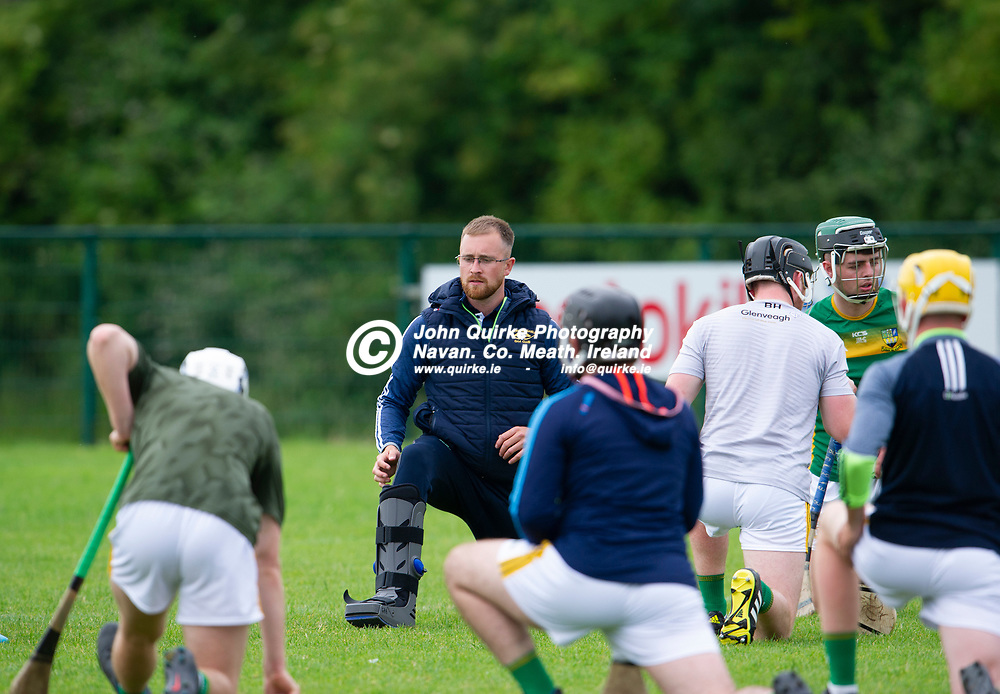 13-07-21. Meath v Wicklow - Leinster U-20 B Hurling Championship (Richie McElligott Cup) 2021 at St. Loman's Park, Trim.<br /> James Andrews wearing a surgical boot demonstrating a stretching exercise during the warm-up.<br /> Photo: John Quirke / www.quirke.ie<br /> ©John Quirke Photography, 16 Proudstown Road, Navan. Co. Meath. (info@quirke.ie / 046-9028461 / 087-2579454).