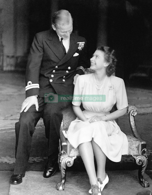 The engagement of Princess Elizabeth to Lieutenant Philip Mountbatten is announced and the happy young couple are pictured together at Buckingham Palace.