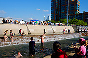Children play in the fountain at Waterfront Park during Thunder over Louisville at Waterfront Park.