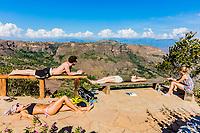 Los Santos , Colombia  - February 12, 2017 : Tourist sunbathing Mesa de Los Santos landscapes andes mountains Santander in Colombia South America