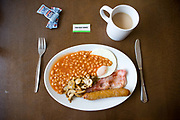 A full English breakfast and cup of tea served at a roadside cafe on the 25th February 2010 in Cambridge in the United Kingdom.
