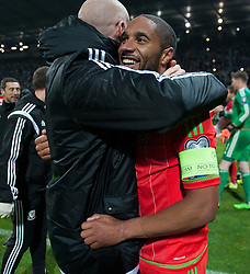 ZENICA, BOSNIA & HERZEGOVINA - Saturday, October 10, 2015: Wales Ashley Williams and James Collins celebrate after securing a place at next years Euro Championships after the Bosnia & Herzegovina vs Wales match at the Stadion Bilino Polje during the UEFA Euro 2016 qualifying Group B match. (Pic by Peter Powell/Propaganda)