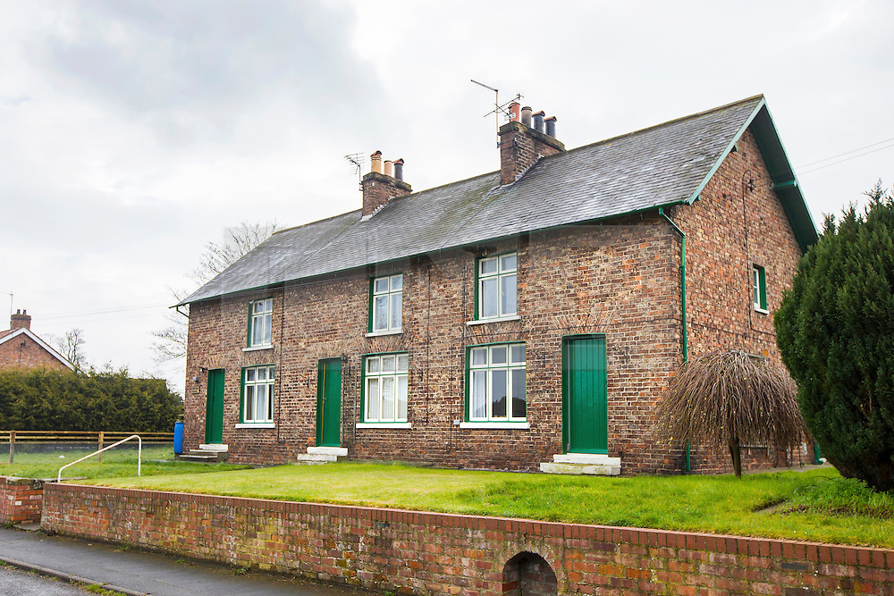 © Licensed to London News Pictures. 03/04/2016. West Heslerton UK. Picture shows houses in West Heslerton. The quintessential Yorkshire village of West Heslerton is up for sale at a price of £20M. The estate has a 21 bedroom historic hall, 43 houses, a pub, garage, church & playing fields. Former owner Miss Eve Dawnay died five years ago & she left a perfectly preserved village that has been untouched for 50 years. Her family are now selling the estate & hopefull of finding a buyer who will share Miss Dawnay's wish to conserve a bucolic way of life. Photo credit: Andrew McCaren/LNP