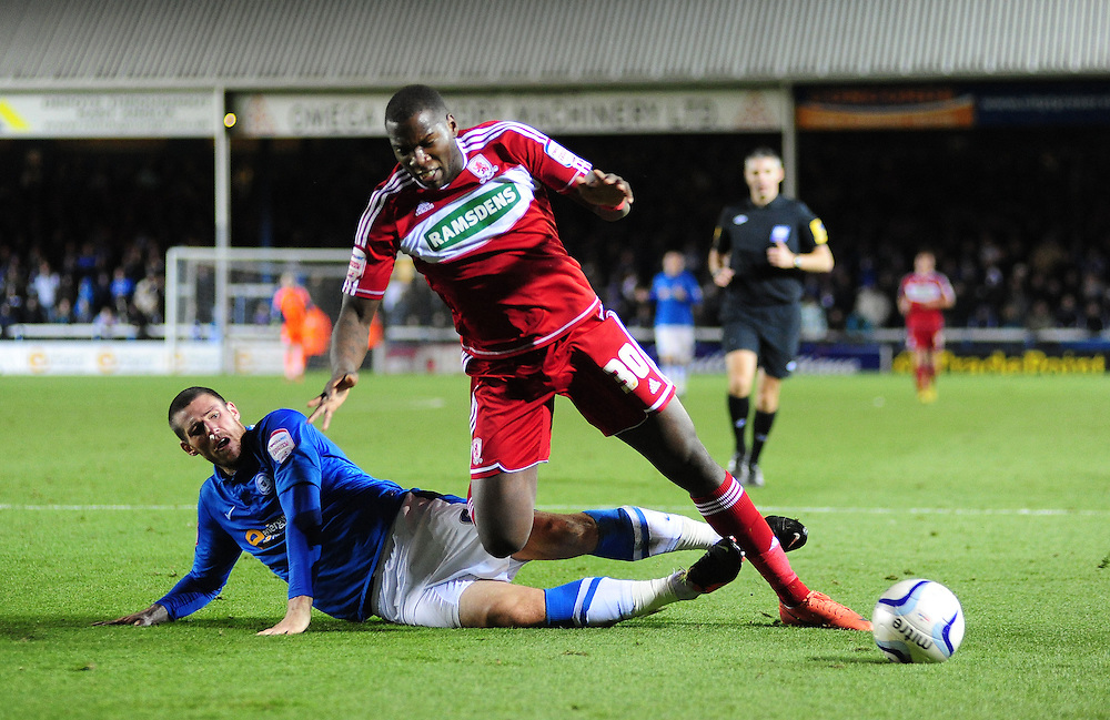 Middlesbrough's Ishmael Miller is tackled by Peterborough United's Michael Bostwick ..Football - npower Football League Championship - Peterborough United v Middlesbrough - Saturday 8th December 2012 - London Road - Peterborough..