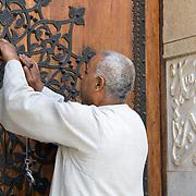 Khedive Tawfik Mausoleum's warden locks its grand doors. Qarafa, Cairo.