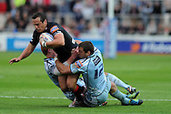 Dan Evans of the Dragons is tackled by Tom Williams ® and Rhys Patchell of the Blues. Rabodirect pro12, Newport Gwent Dragons v Cardiff Blues at Rodney Parade, Newport,  South Wales on Sat 15th Sept 2012.   pic by  Andrew Orchard, Andrew Orchard sports photography,