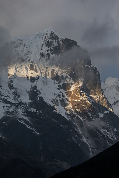 Moody skies over the stunning North Pillar of Teng Kang Poche in Nepal