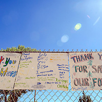 062314  Adron Gardner<br /> <br /> Signs of support for firefighters decorate the fences across from the field house in Fort Defiance Monday.