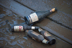 © Licensed to London News Pictures. 29/12/2015. York, UK.  Bottles from a Christmas party lie in mud after floodwaters receded in Huntingdon Road in the centre of York on December 29, 2015. Further rainfall is expected over coming days as Storm Frank approaches the east coast of the country. Photo credit: Ben Cawthra/LNP
