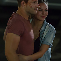 Australian actor Jai Courtney (L) poses for a photo with his girlfriend Thai born Australian actress Gemma Pranita Xumsai (R) in the set during a break of his next movie fifth in the Die Hard series titled Good Day to Die Hard in Budapest, Hungary on July 11, 2012. ATTILA VOLGYI