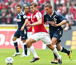 23.07.2011,  Rhein Energie Stadion, Koeln, GER, FSP, 1. FC Koeln vs Arsenal London, im Bild: Jack Wilshere (Arsenal #19) (L) gegen Lukas Podolski (Koeln #10) (R)...// during the friendly match, 1. FC Koeln vs Arsenal London on 2011/07/23, Rhein-Energie Stadion, Köln, Germany. EXPA Pictures © 2011, PhotoCredit: EXPA/ nph/  Mueller *** Local Caption ***       ****** out of GER / CRO  / BEL ******
