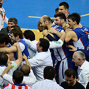 Anadolu Efes's players celebrate victory during their Turkish Airlines Euroleague Basketball PlayOffs Round 3 match Anadolu Efes between Real Madrid at Abdi ipekci arena in Istanbul, Turkey, Tuesday April 21, 2015. Photo by Aykut AKICI/TURKPIX
