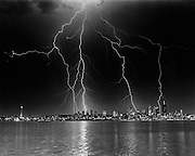 The downtown Seattle skyline is highlighted by lightning in this time-exposure photograph taken from Duwamish Head. (Greg Gilbert / The Seattle Times, 1984)