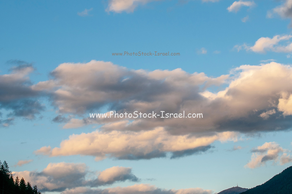 Cumulus Cloud formations with blue sky background. Photographed in Stubai, Tyrol, Austria in September
