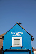 A bight blue exterior wall of The Blue Dolphin Fish Bar on the 20th April 2019 in Hastings in the United Kingdom. Hastings is a town on England's southeast coast, its known for the 1066 Battle of Hastings.