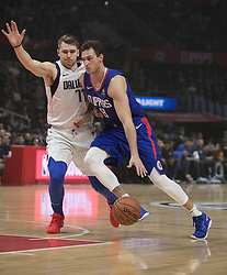 December 20, 2018 - Los Angeles, California, U.S - Danilo Gallinari #8 of the Los Angeles Clippers drives past Luka Doncic #77 the Dallas Mavericks during their NBA game on Thursday December 20, 2018 at the Staples Center in Los Angeles, California. Clippers vs Mavericks. (Credit Image: © Prensa Internacional via ZUMA Wire)