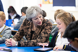 © Licensed to London News Pictures . 30/04/2018. Manchester , UK. British Prime Minister THERESA MAY meets year 6 students during a visit to Brooklands Primary School in Sale . May is facing questions over her role in the scandal of the way Windrush migrants have been treated and after the resignation of Home Secretary, Amber Rudd, late last night (29 April 2018) . Photo credit : Joel Goodman/LNP