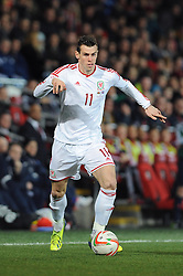 Gareth Bale of Wales (Real Madrid) in action against Iceland in an international friendly - Photo mandatory by-line: Dougie Allward/JMP - Tel: Mobile: 07966 386802 03/03/2014 -