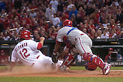 17 May 2011                             St. Louis Cardinals right fielder Lance Berkman (12) slides safely into home plate past Phillies catcher Dane Sardinha (4, right) in the bottom of the fourth after teammate Yadier Molina singled to left field.  The St. Louis Cardinals defeated the Philadelphia Phillies 2-1 on Tuesday May 17, 2011 in the second game of a two-game series at Busch Stadium in downtown St. Louis.