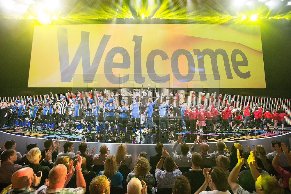 """© Licensed to London News Pictures . 03/07/2014 . Leeds , UK . Live music performance with roller skaters, children's choir and brass band performing with """" The Band Anyone Can Join """" .  Tour de France Team Presentation in front of a live audience of 10,000 people at the Leeds Arena and worldwide TV audience in excess of 300 million . Photo credit : Joel Goodman/LNP"""