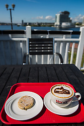 Cardiff, UK. 2nd May, 2017. A cappuccino and a Welsh scone served at the Norwegian Church Arts Centre on Cardiff Bay. The Norwegian Church was built in 1868 and served as a Lutheran place of worship for Scandinavian sailors and the local Norwegian community until deconsecrated in 1974.