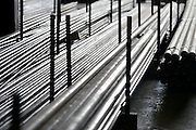Nederland, Nijmegen, 28-4-2014In een hal, magazijn van een metaalbedrijf liggen stapels met metalen, ijzeren,stalen, buizen.Foto: Flip Franssen/ Hollandse Hoogte