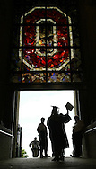 (GRAD14 LAFFERTY SHILLING 6/13/03)Graduates and event workers mill around the ramp at the north rotunda  of Ohio Stadium during Ohio State's spring commencement ceremony. (NAME CQ)(Photos for the DIspatch by Will Shilling)