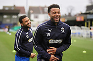 AFC Wimbledon midfielder Tom Soares (19) and AFC Wimbledon midfielder Andy Barcham (17) warming up before the EFL Sky Bet League 1 match between AFC Wimbledon and Plymouth Argyle at the Cherry Red Records Stadium, Kingston, England on 26 December 2018.