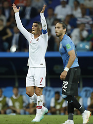 (L-R) Cristiano Ronaldo of Portugal, Martin Caceres of Uruguay during the 2018 FIFA World Cup Russia round of 16 match between Uruguay and at the Fisht Stadium on June 30, 2018 in Sochi, Russia