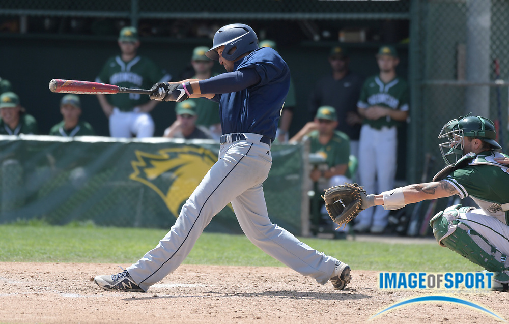 Cal State Monterey Bay Otters outfielder Darren Kritz follows through on a double during an NCAA College baseball game against the Cal  Poly Pomona Broncos in Pomona, Calif., Friday, April 13, 2018.