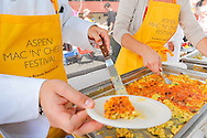 """Paco Ortiz from Jimmy's restaurant serves up a healthy portion of """"Jimmy Mac"""" during Aspen's first Mac 'N' Cheese Festival in Aspen, Colorado."""