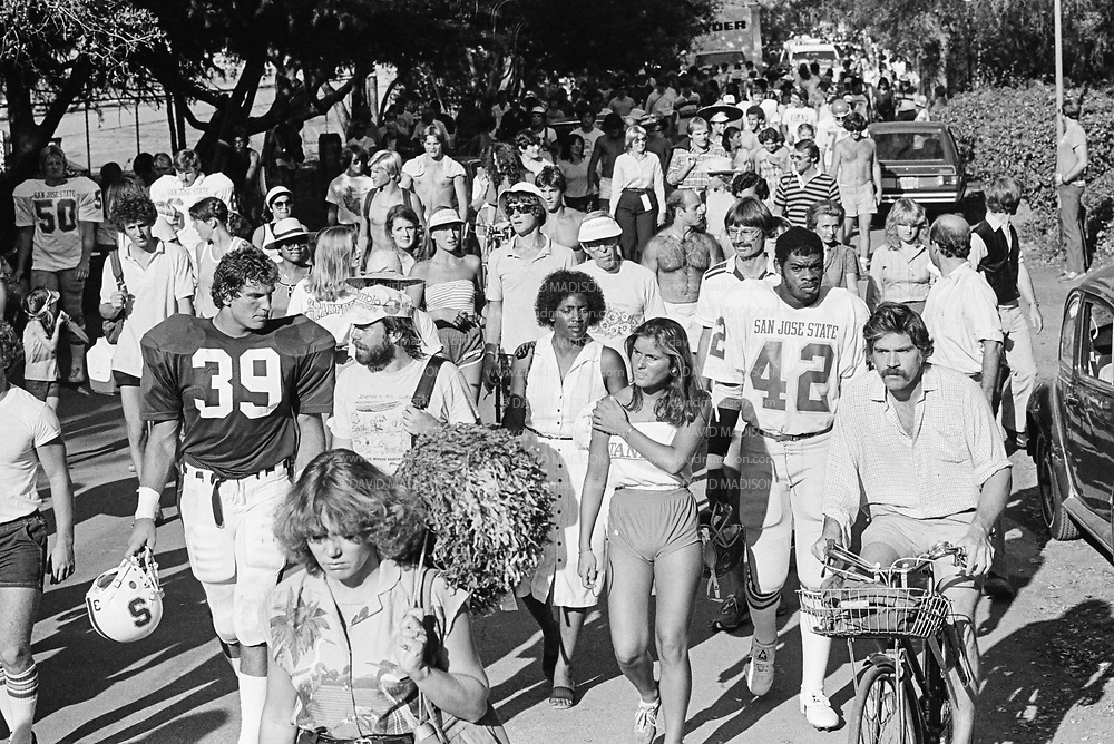 COLLEGE FOOTBALL:  Stanford vs San Jose State on October 4, 1980 at Stanford Stadium in Palo Alto, California.  Players and fans walk outside the stadium after game.  Todd Wasik #39.  Photograph by David Madison ( www.davidmadison.com ).