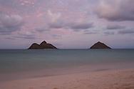 The full moon rises over the Mokes, two lava islands off the coast of Kailua, Hawaii.