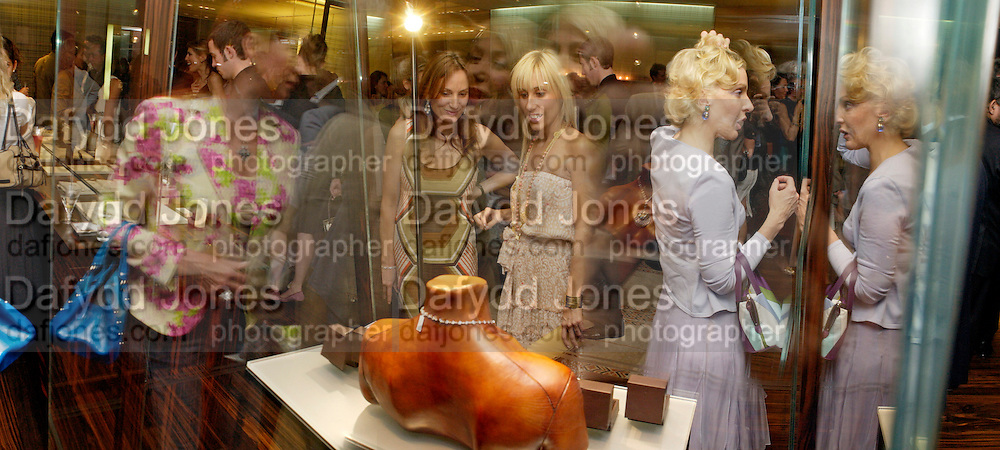 Emily Oppenheimer and Princess Alexandra von Furstenburg looking at jewelry. . Book launch of ' The Russian House'  by Ella Krasner at De Beers. 50 Old Bond St. London W1. ONE TIME USE ONLY - DO NOT ARCHIVE  © Copyright Photograph by Dafydd Jones 66 Stockwell Park Rd. London SW9 0DA Tel 020 7733 0108 www.dafjones.com