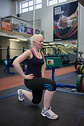 Partially-sighted skiing paralympian from the Sochi Olympics, Kelly Gallagher trains in the gym at the Sports Institute, University of Ulster, Northern Ireland, UK. Doping squats to build strength in her thighs, she starts a new training regime for the forthcoming winter season. Kelly Marie Gallagher, MBE is a Northern Irish skier and the first athlete from Northern Ireland to compete in the Winter Paralympics. Gallagher won Britain's first ever Winter Paralympic gold medal during Sochi 2014.