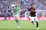 Kristoffer Ajer and Danny Amankwaa chase the ball during the Betfred Semi-Final Cup match between Heart of Midlothian and Celtic at Murrayfield, Edinburgh, Scotland on 28 October 2018.