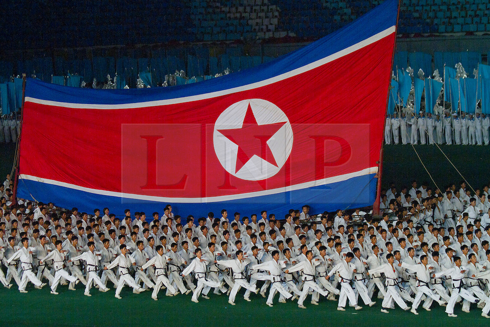 © Licensed to London News Pictures. 10/08/2011. Pyongyang, North Korea. Thousands of Tae Kwon Do experts perform a synchronised routine as part of the Arirang Mass Games in Pyongyang.  The 100,000 performers train for up to three years before being ready to perform at the event which takes place nightly for around two months in summer each year. Photo credit : James Gourley/LNP/