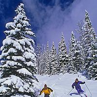 "A couple skis new powder on ""Stump Farm"" run at Montana's Big Sky resort."
