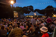 A large crowd relaxes at the Prospect Park bandshell at the first intermission of the performance of Les Ballets Trockadero de Monte Carlo.