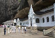 People at Dambulla cave Buddhist temple complex, Sri Lanka, Asia